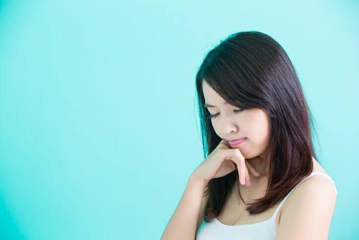 beauty skincare woman feel upset on green background
