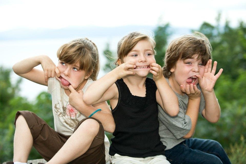 three kids messing around