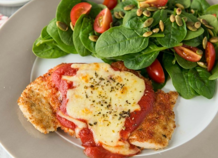 Chicken parmigiana with salad