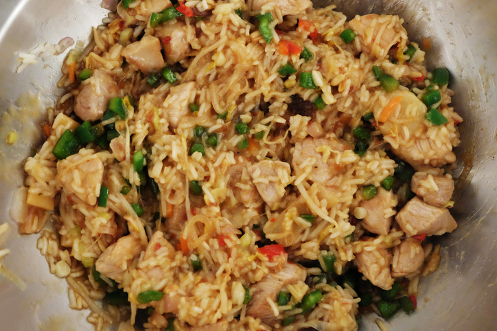 wok pan with rice, meat, paprika