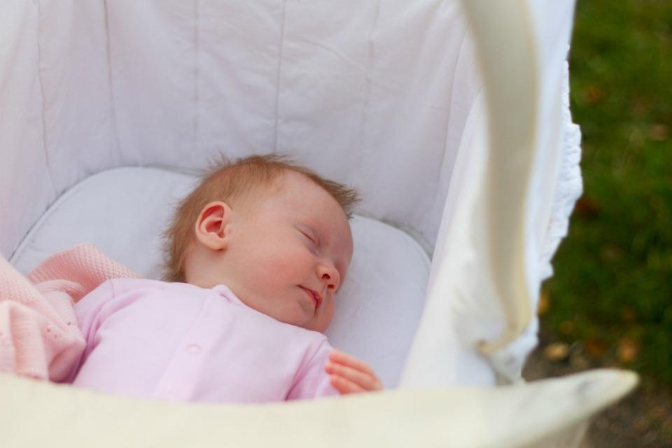newborn baby outside in pram