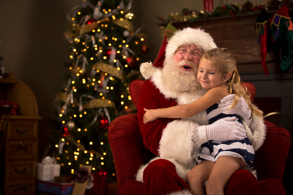 Santa Claus hugging child