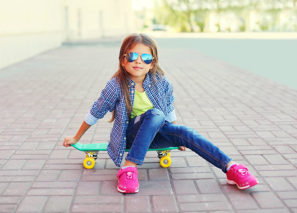 trendy girl on skateboard