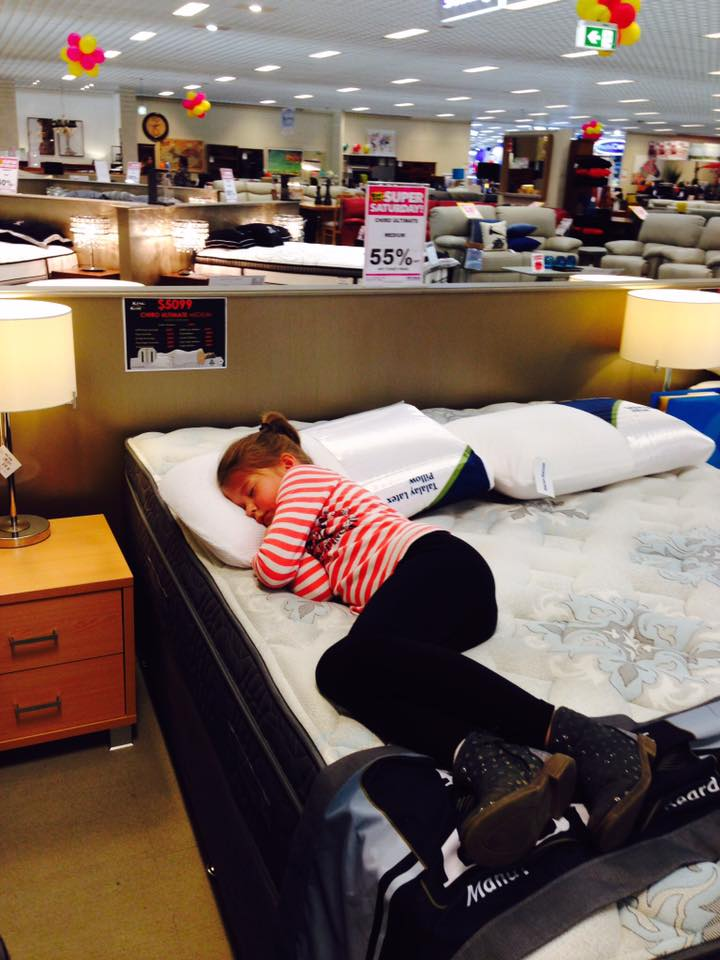 funny-places-kids-fall-asleep-department-store-bed