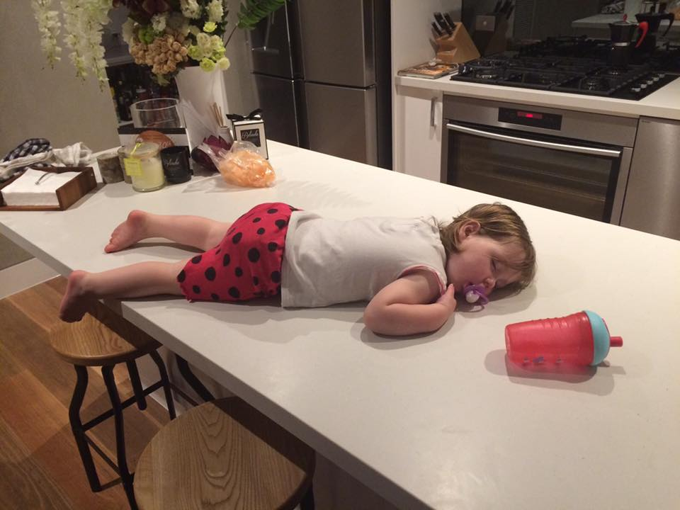 funny-places-kids-fall-asleep-kitchen-bench-via-The-Healthy-Mummy