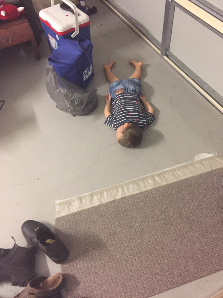 hilarious-places-kids-fall-asleep-garage-floor