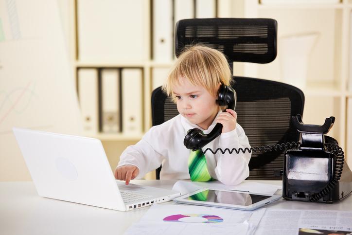 Little boy surfing the net.
