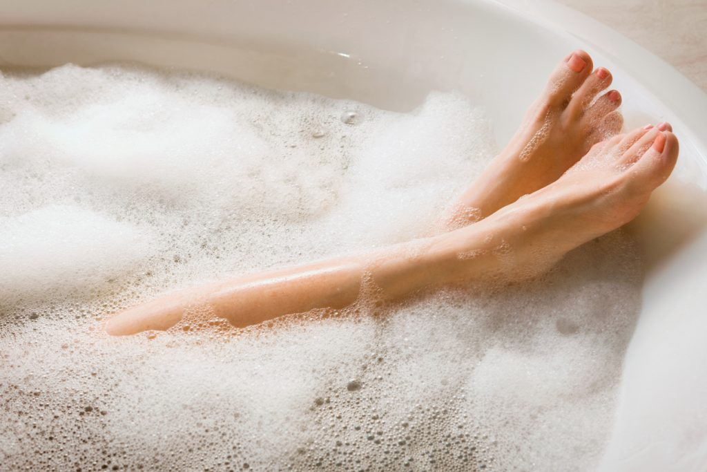 Woman's Legs & Feet in Bubble Bath