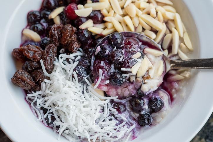 Superfood Vegan Breakfast Bowl of Oatmeal, Blueberries, Almonds, Coconut, Raisins