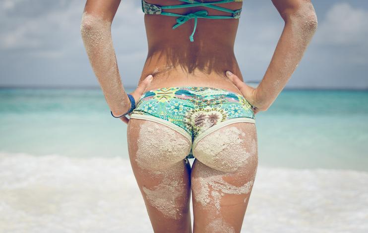 woman back on the beach