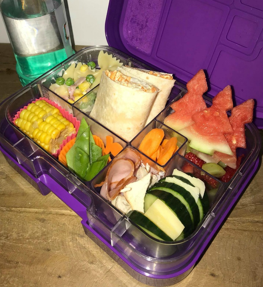 lunch box with fresh fruit and vegetables