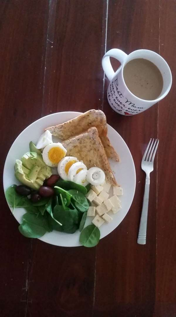 Hard boiled egg with toast and spinach