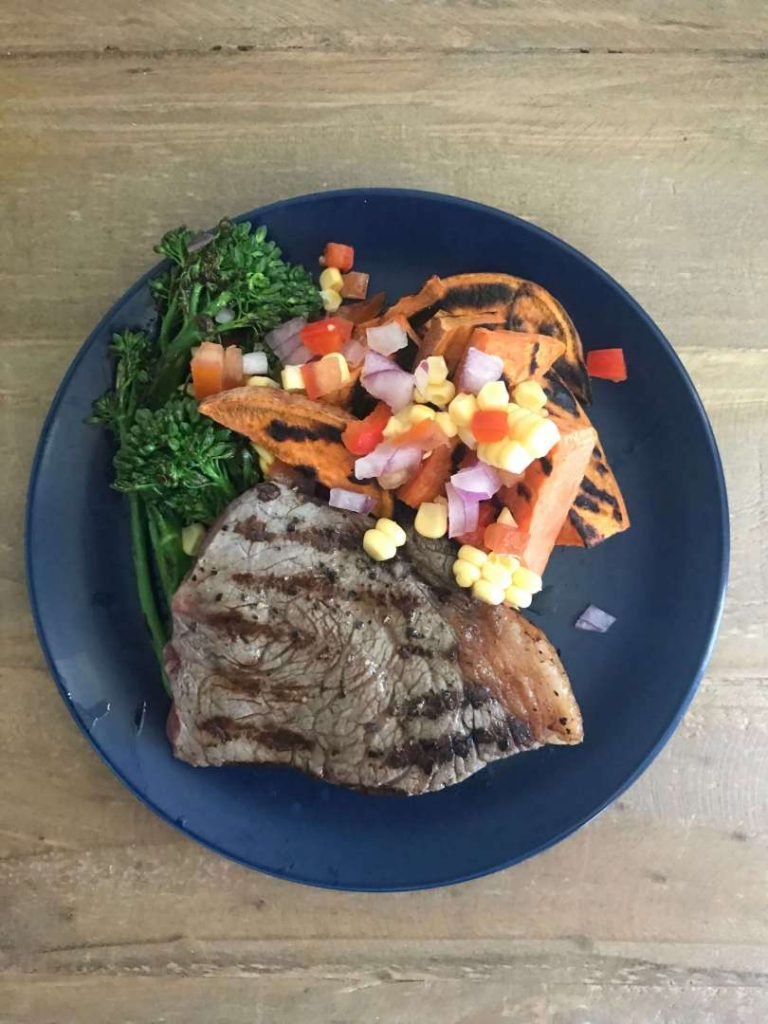 Grilled steak with sweet potato wedges and salsa