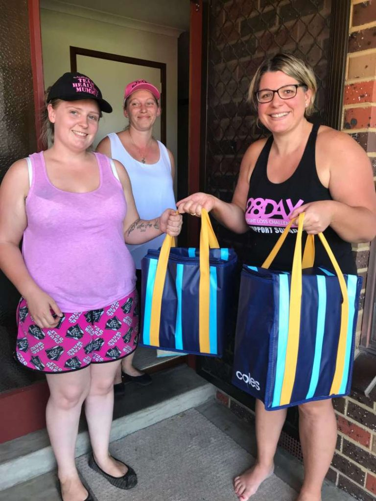 Nikola Green donating the meals to mums in her community
