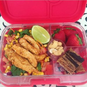 packed lunch box filled with fruit and nuts